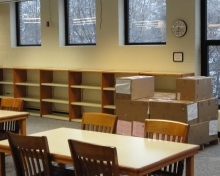 Empty library shelves before moving day